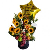 Girasoles, frutas, vino y chocolates